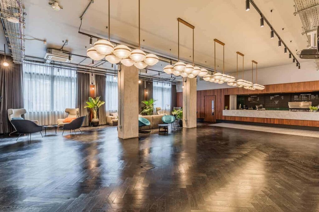 Industrial venue with warm accents for meetings