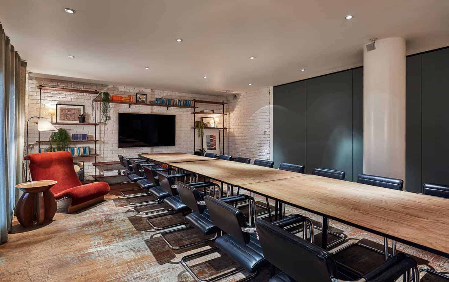 Funky meeting space with quirky decorations and brick walls