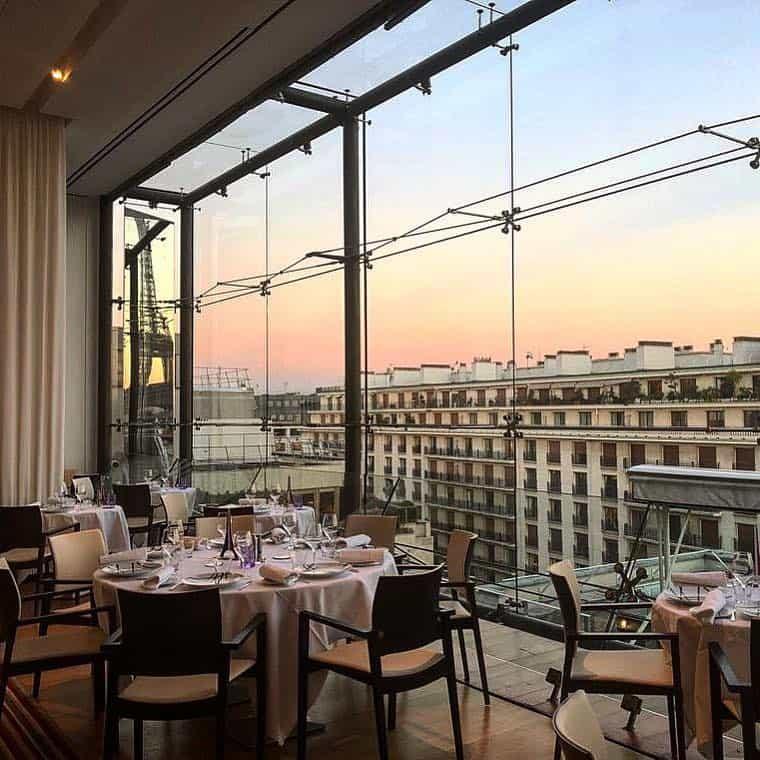 Beautiful glass dining space overlooking Paris