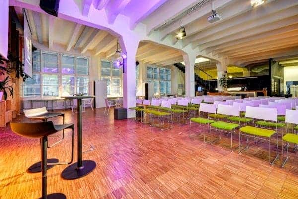 Hip industrial conference hub with breakout areas