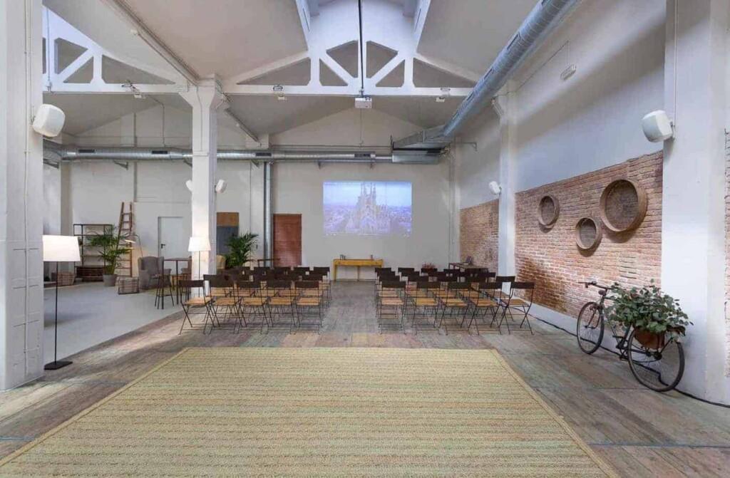 Luminous multipurpose venue with rustic character