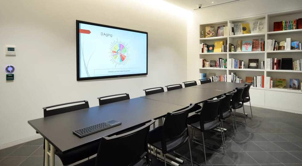 Sleek meeting location with a book's display