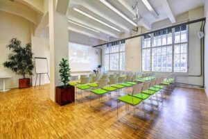 White conference venue with industrial elements