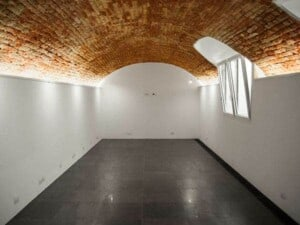 Clean white space with historical vaulted brick ceiling