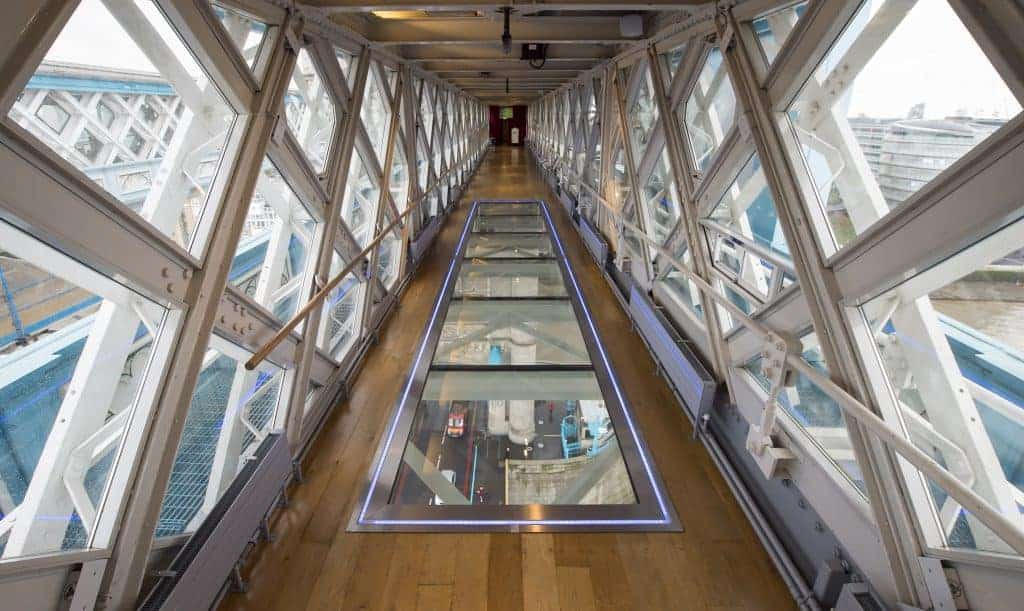 Beautiful glass venue with panoramic views of London. Wood flooring and floor-to-ceiling windows