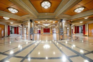 Spectacular circle-shaped venue featuring wooden panelling, beautiful marble floors and high ceilings.