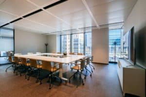 Luminous venue with a sleek design featuring polished floors and floor-to-ceiling windows.