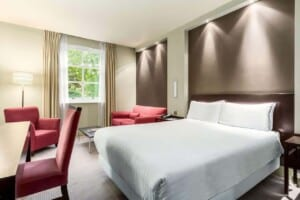 Modern and elegant hotel with a stylish interior, Rooms with a sleek and contemporary decoration.