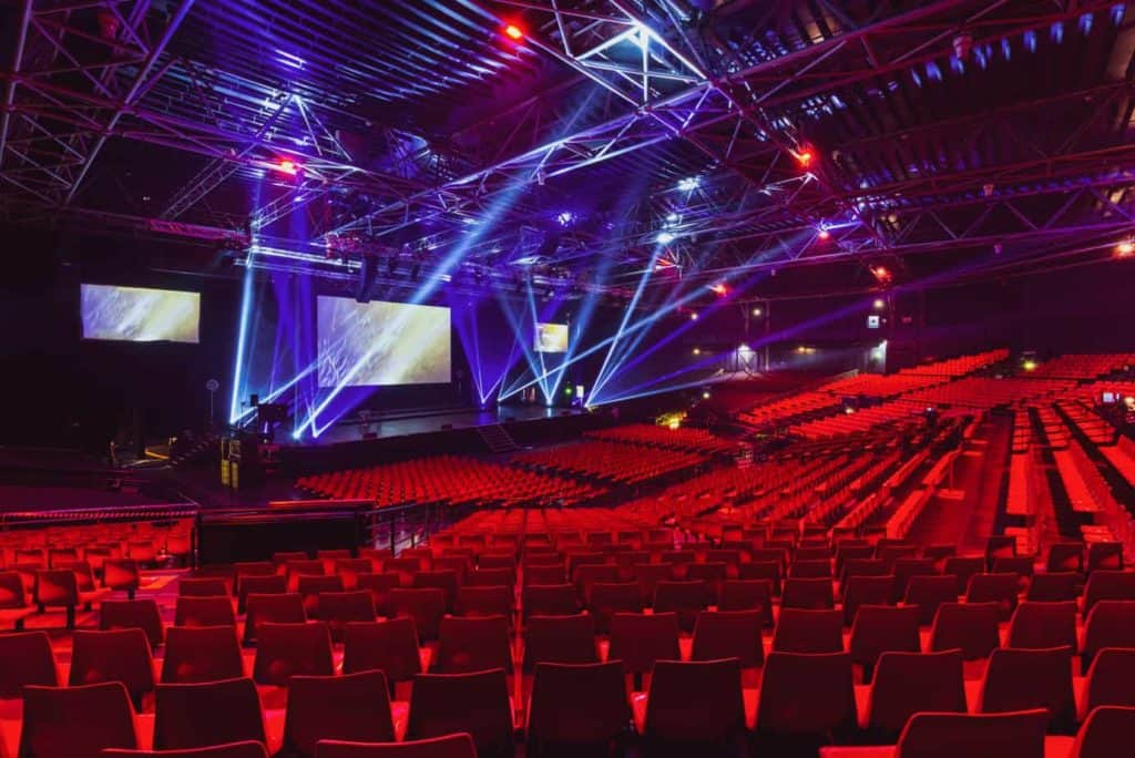 Modern conference venue with comfortable red theatre seating