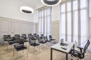 Stylish meeting room with elegant décor featuring wooden panelling, parquet floors and high ceilings.