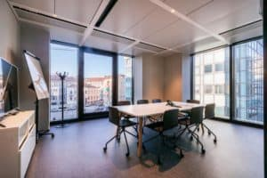 Stylish meeting space with a professional look featuring modern furniture and plenty of natural light.