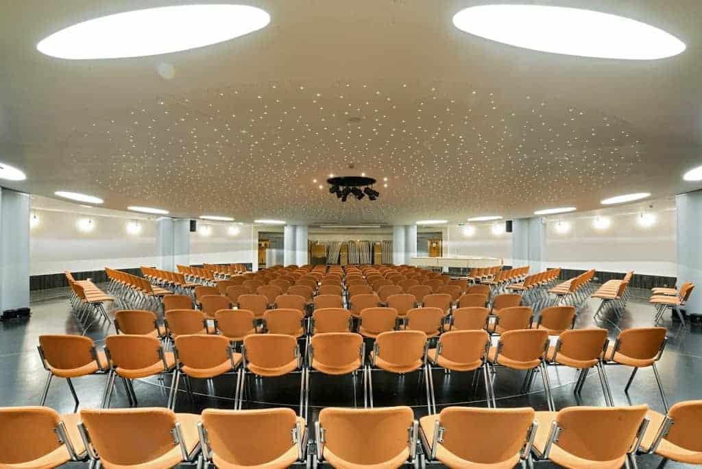 Futuristic conference venue with starlight ceiling