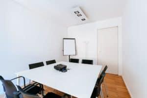 White innovative room for meetings boasting white walls and plenty of natural light.