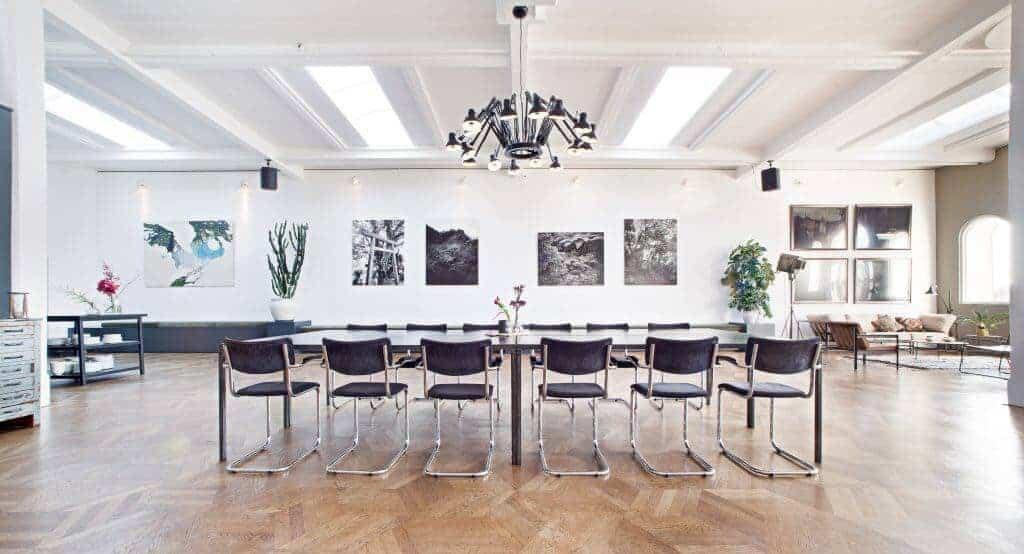 Classic meeting space with herringbone flooring and white walls