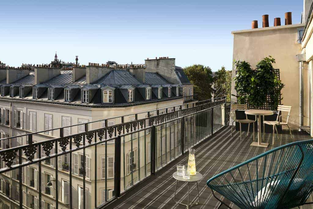 Luxurious hotel with splendid balconies overlooking Paris' skyline