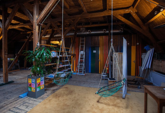 Wooden attic for casual brainstorms, workshops and more