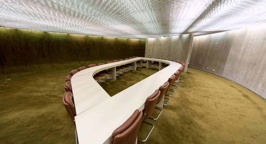 Futuristic Meeting Room with green carpet and innovative ceiling