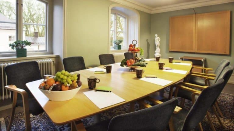 Bright boardroom with a refined style featuring classy decor and elegant furniture.