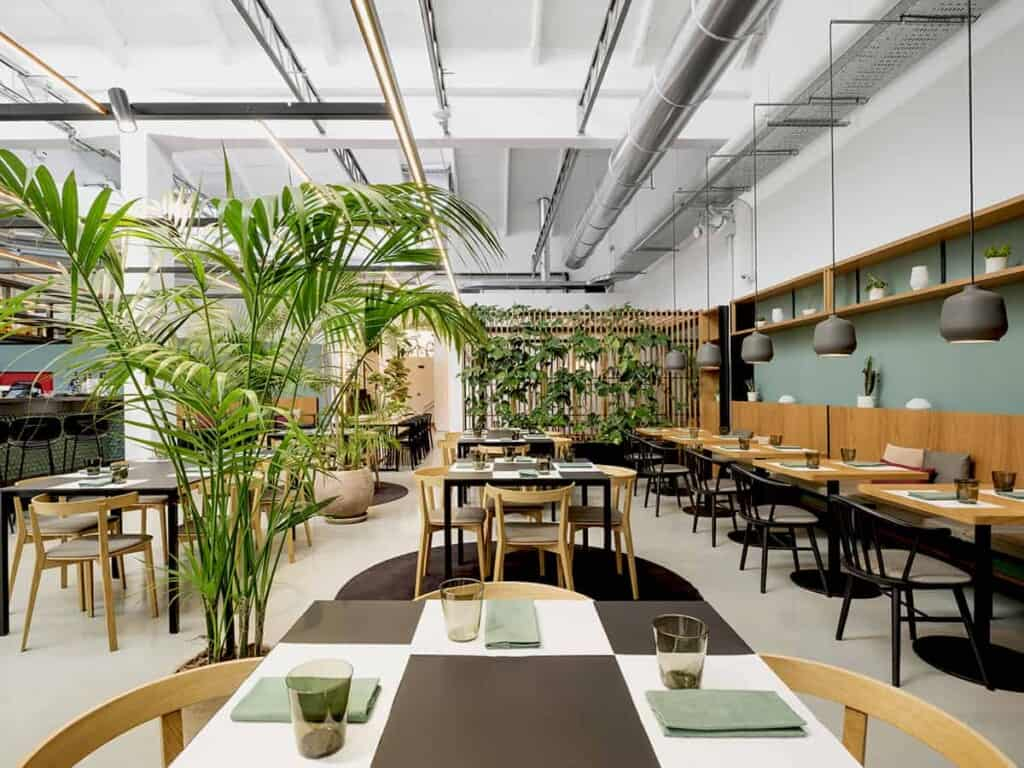 Contemporary dining space with a welcoming atmosphere featuring an industrial and modern design.
