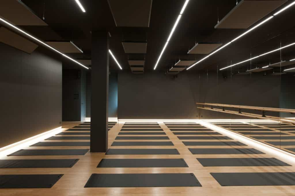 Dark yoga space with special lighting and warm atmosphere
