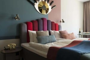 Gorgeous hotel housed in an historical castled featuring pastel tones and chic décor.