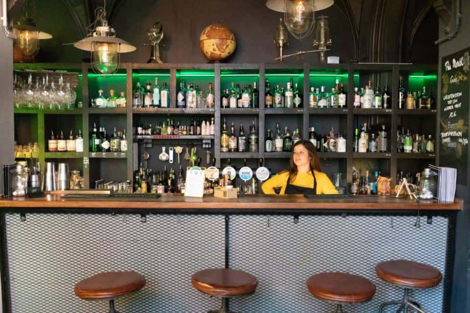 Bar tender behind a hip bar in Brussels