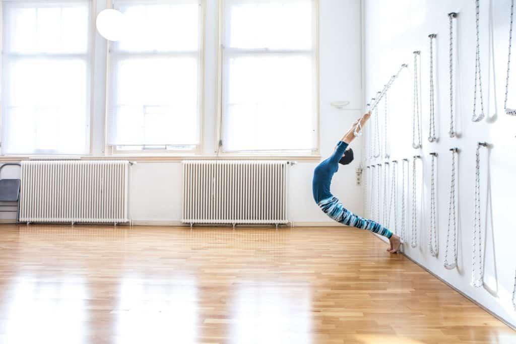 Woman practising yoga in luminous classroom