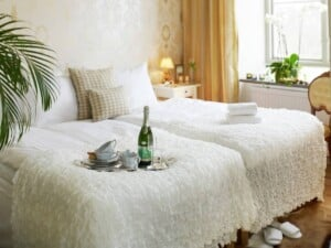 Magnificent hotel with a warm and cosy style combining simple modern furniture and period ornaments.