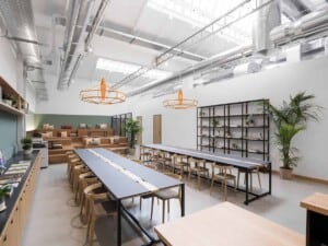 Modern event space with an industrial touch featuring uncovered ceilings and modern furniture.