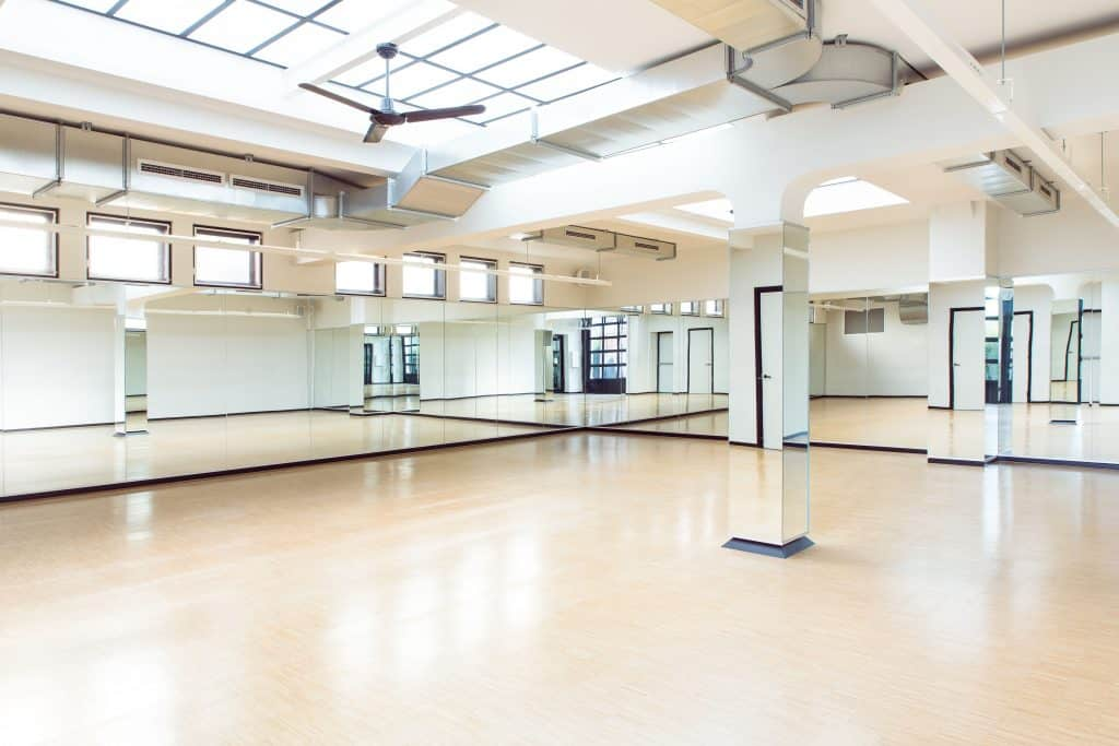 Spacious yoga location with mirrors