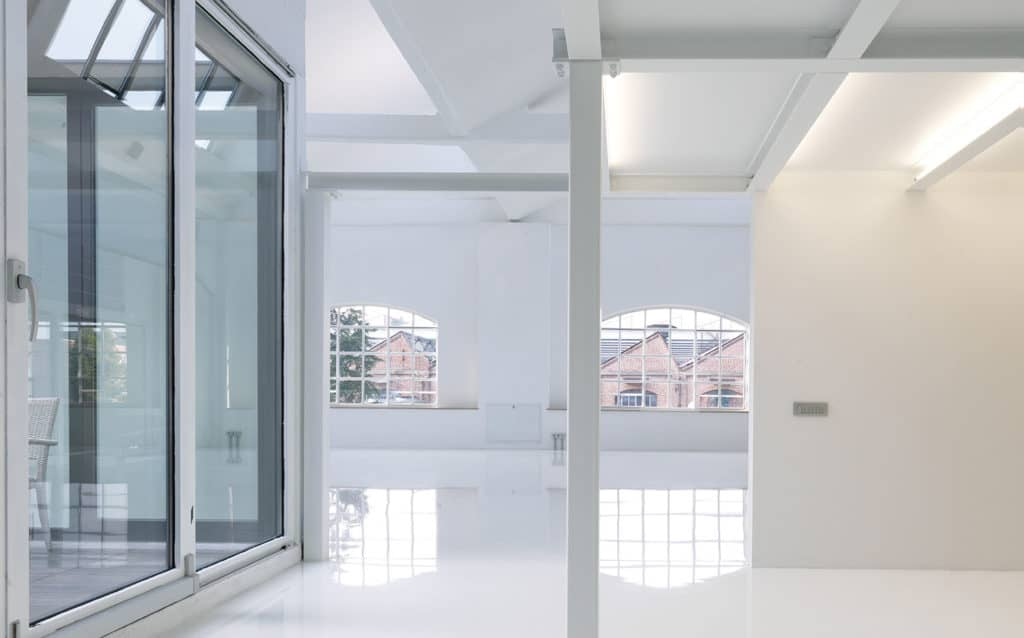 Multipurpose white loft with an uncluttered design featuring a minimalistic aesthetic.