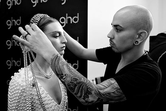 Peter Burkhill, hair stylist, adjusting the hairstyle of a model in London