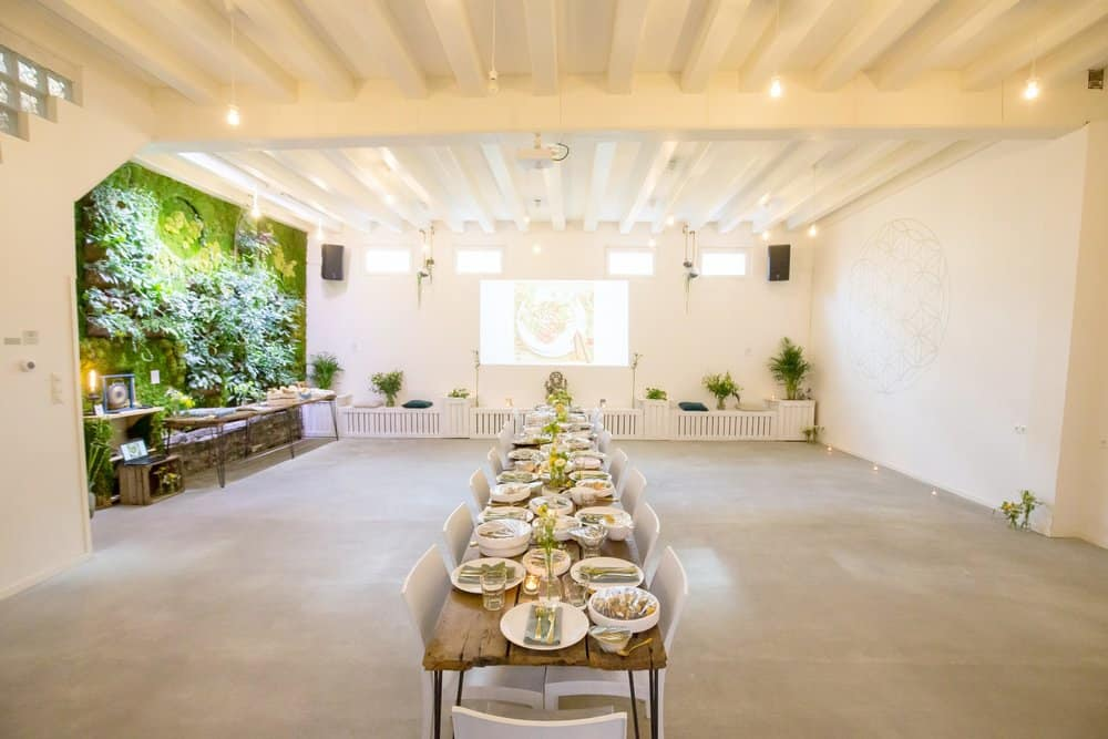 Private dining event in white open space with vegan food