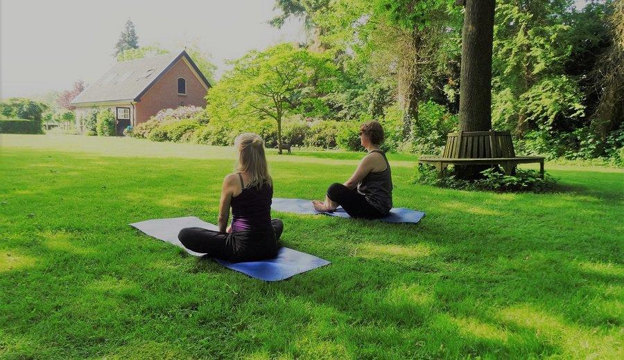 Outdoor meditation in a grassfield