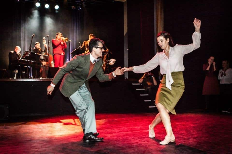 Couple dancing in one of many lindy hop classes in Brussels