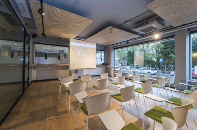 Luminous meeting room with parquet flooring and industrial ceiling