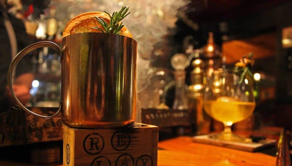 Close-up of a cocktail in a cocktail bar with cosy and warm atmosphere