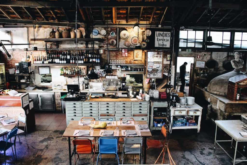 Snapshot of the industrial interior of a lunch spot in Lisbon