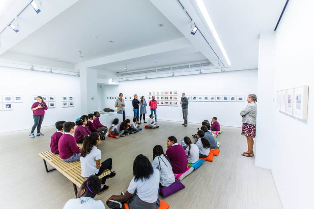 Group of people listening to a guide in a museum