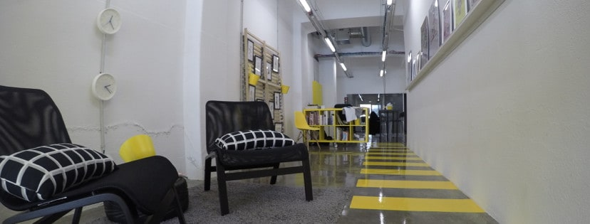 Entrance of co-working with industrial outlook and yellow colour accents