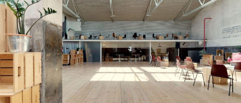 Open industrial meeting space with natural light