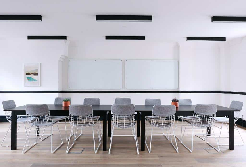 Sleek and modern meeting room with white walls and parquet flooring