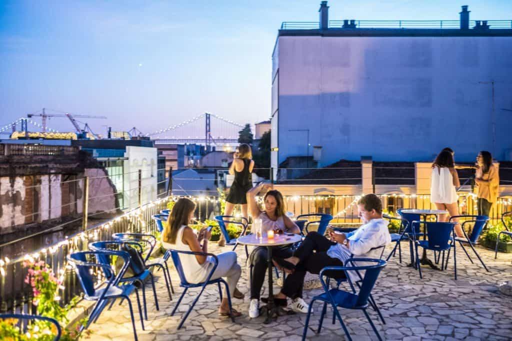 Friends enjoying a drink on a rooftop bar
