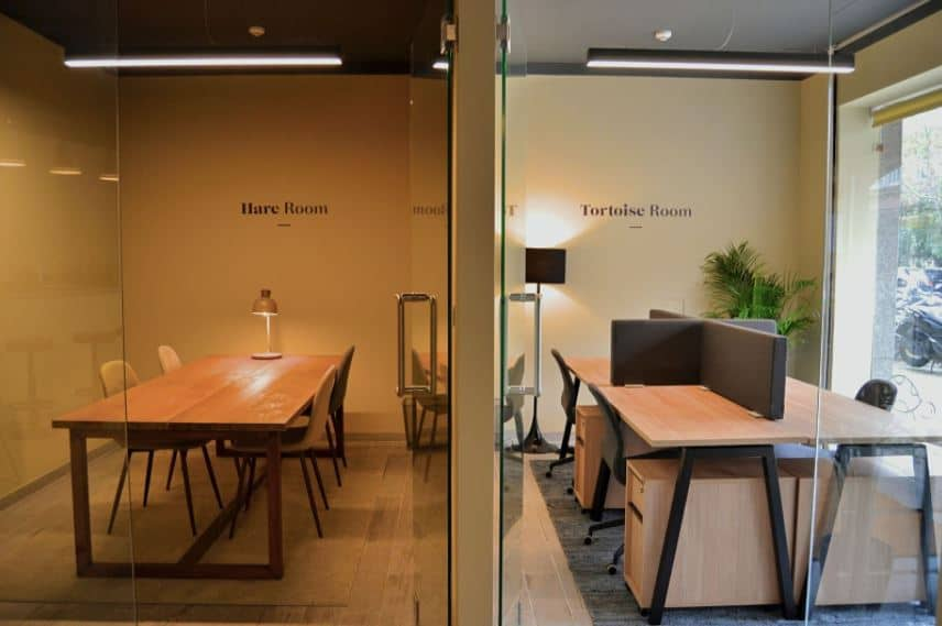 Small meeting rooms with parquet flooring, wood furniture and warm atmosphere