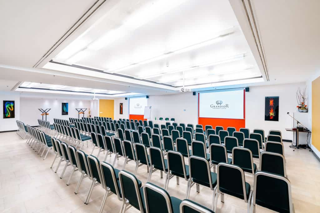 Spacious and luminous conference room with yellow and orange accents