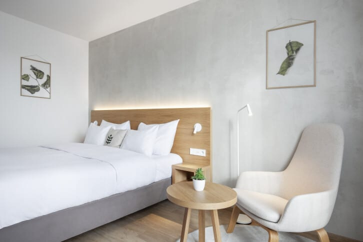 Minimalist bedroom with grey, white and wood colours