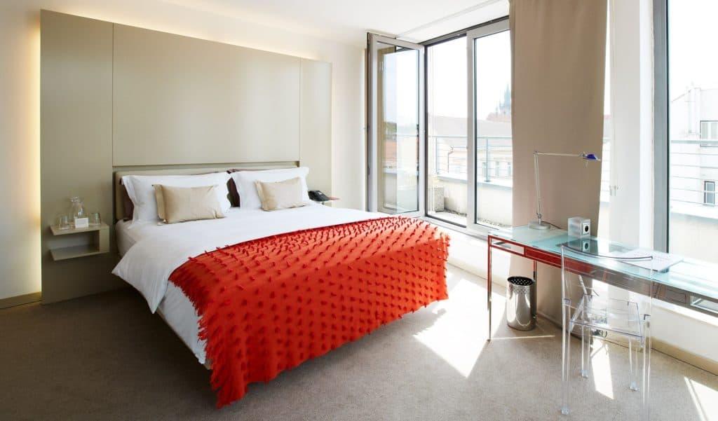 Sleek and modern bedroom with floor-to-ceiling window