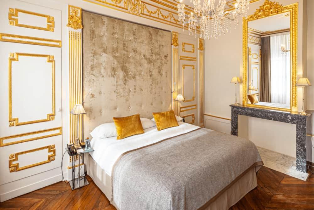 gold and white elegant hotel room