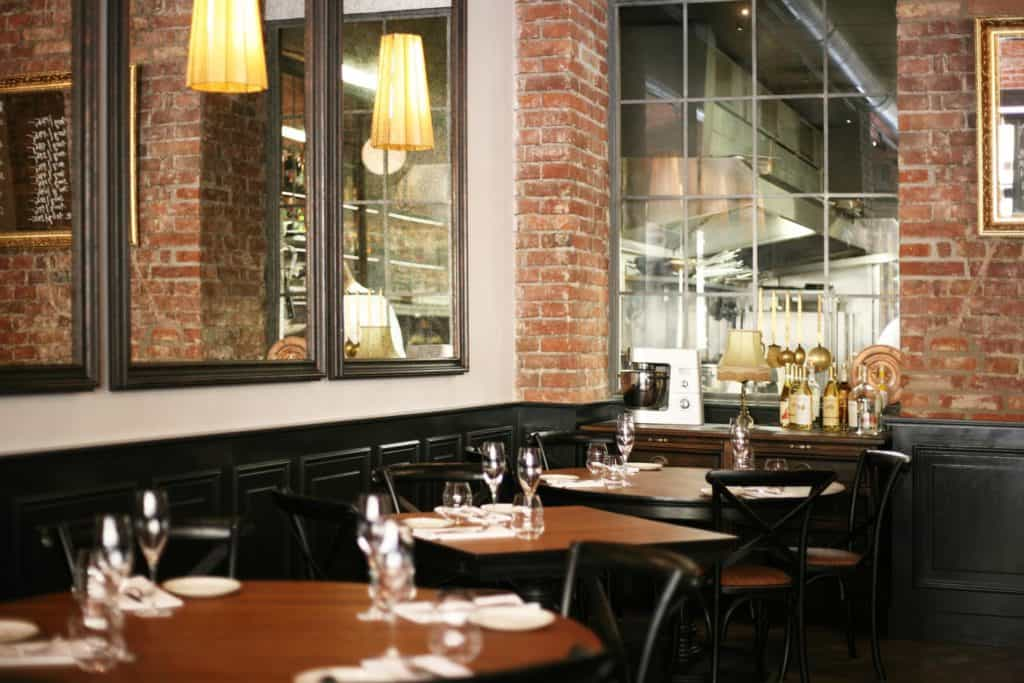 Restaurant with classic interior combined with exposed brick walls