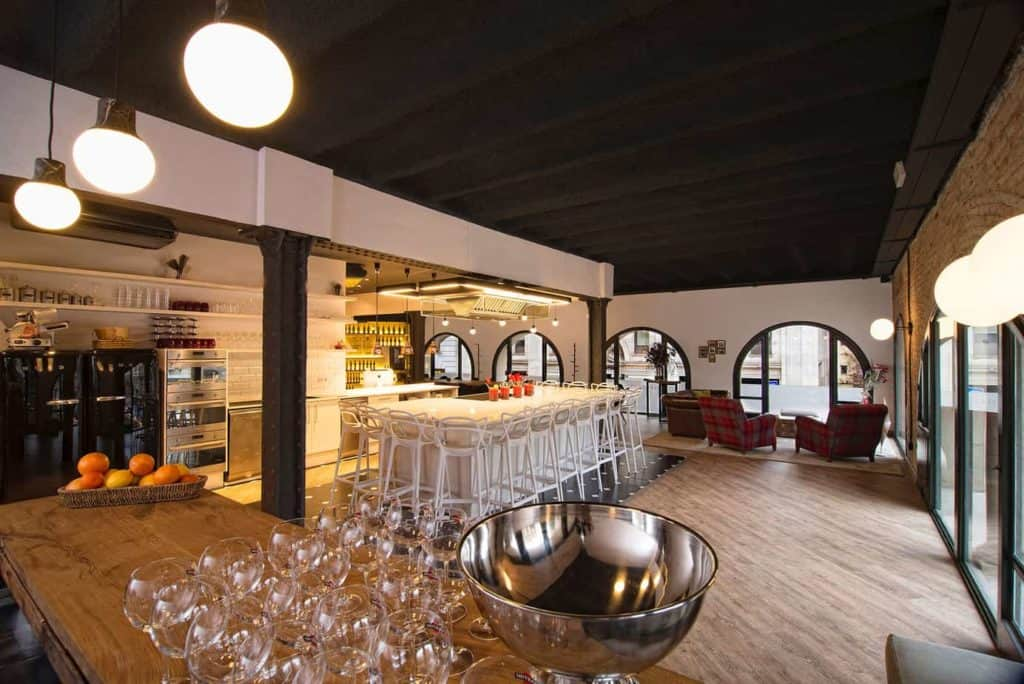 Warm and modern event venue with parquet flooring and trendy furniture